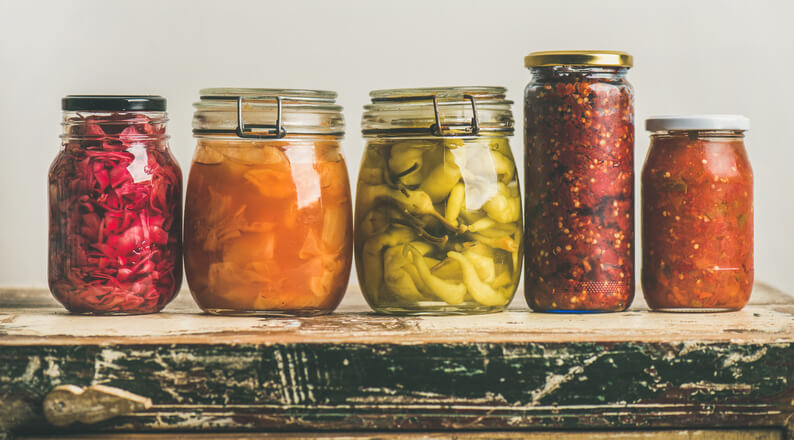 stack of mason jars with fermented foods